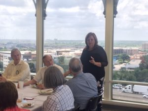 Action Shot teaching the Wow to a Dallas business group